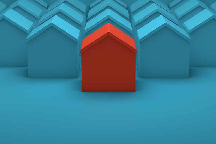 מודל של בית אדום בין מודלים של בתים כחולים